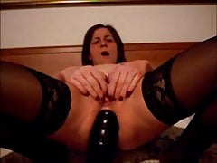 Mature brunette anal riding a big black dildo and recording